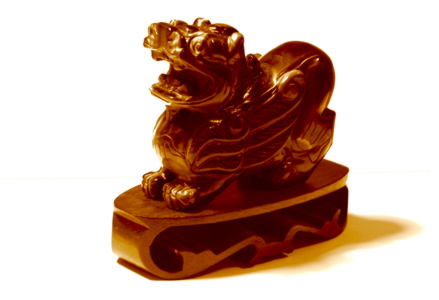 Red Jade Lion Image by FreeImages.com / Tom Low